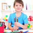 Cute little boy drawing in his album — Stock Photo #20017959