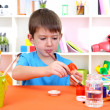 Cute little boy painting easter eggs — Stock Photo #20017979