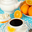 Stock Photo: Beautiful white dinner service with oranges on blue tablecloth close-up