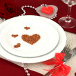 Table setting in honor of Valentine's Day close-up — ストック写真