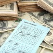Stock Photo: Lottery ticket and money, close up