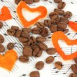 Decorative hearts from dry orange peel with coffee beans on musical notes — Stock Photo #20018303