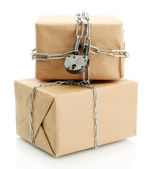 Parcels with chains, isolated on white — Stock Photo