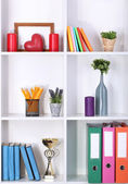 Beautiful white shelves with different home related objects — Foto de Stock