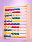 Bright wooden toy abacus, on purple background — Stock Photo