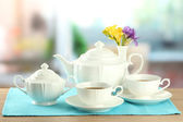 Beautiful tea service on wooden table — Stock Photo