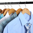 Shirts with ties on wooden hangers isolated on white — Stock fotografie
