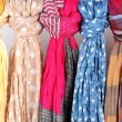 Stock Photo: Many bright female scarfs close-up