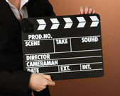 Movie production clapper board on color background — Stock Photo