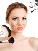 Portrait of beautiful woman with make-up brushes, isolated on white — Stock Photo