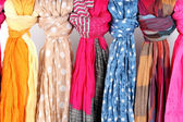Many bright female scarfs close-up — Stok fotoğraf