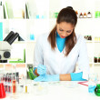 Young scientist with Petri dish in laboratory — Stock Photo #20055971