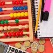 Bright wooden abacus and calculator. Conceptual photo of old and modern business — Stock Photo #20056383