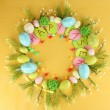 Circular composition for Easter on yellow background — Zdjęcie stockowe