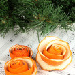 Decorative rose from dry orange peel on musical notes — Stock Photo