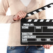 Movie production clapper board in hands isolated on white — Stock Photo #20056559