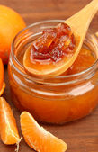 Tasty homemade mandarine jam, on wooden table — Stock Photo