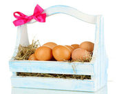 Easter eggs in wooden basket isolated on white — Stock Photo