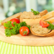 Composition of fresh pate, tomatoes and bread, on bright background - Stok fotoğraf