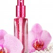 Women's perfume in beautiful bottle and orchid flowers, isolated on white — Stock Photo #20102253