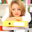 Tired business woman working in office — Stock Photo