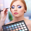 Portrait of beautiful young woman with making makeup in beauty salon — Stock Photo
