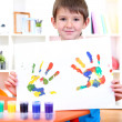 Cute little boy with his colorful handprint — Stock Photo