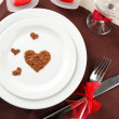 Table setting in honor of Valentine's Day close-up — Stock Photo
