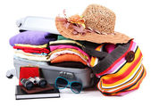 Closed silver suitcase with clothing isolated on white — Stock Photo
