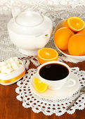 Beautiful white dinner service with oranges on wooden table close-up — Stock Photo