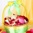 Stock Photo: Wedding basket with rose petals