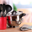 Kitchen tools on table in kitchen — Stock Photo #20165599