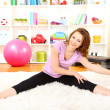 Young woman doing fitness exercises at home — Stock fotografie