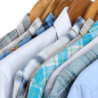 Shirts with ties on wooden hangers close-up — Stok fotoğraf