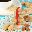 Aromatic cookies cantuccini and cup of coffee on blue tablecloth close-up — Stock Photo