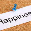 Push pin on paper with word happiness on cork board — Stock Photo