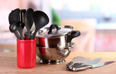 Kitchen tools on table in kitchen — Stock Photo