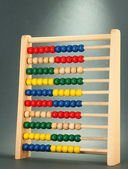 Bright wooden toy abacus, on grey background — Stock Photo