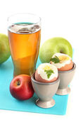 Light breakfast with boiled eggs and glass of juice, isolated on white — Stock Photo