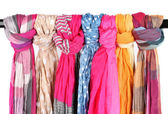 Many bright female scarfs isolated on white — Stock Photo