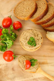 Fresh pate on wooden spoon, on wooden background — Stock Photo