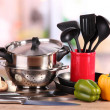 Composition of kitchen tools and vegetables on table in kitchen - Photo