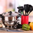 Composition of kitchen tools and vegetables on table in kitchen - Stockfoto