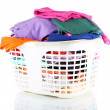 Clothes in plastic basket isolated on white - Photo
