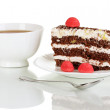 A cup of tea and delicious cake isolated on white - 图库照片