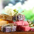 Natural handmade soap, on wooden table, on green background — Stok fotoğraf