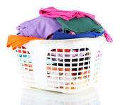 Clothes in plastic basket isolated on white — Stock Photo