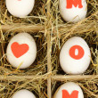 Decorative Easter eggs in wooden basket close up — Stock Photo