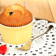 Cupcake in bowl for baking on wooden table — Stock Photo