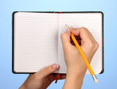 Hand write on notebook, on color background — Stock Photo